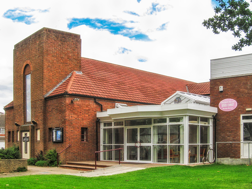 Church exterior photograph showing the new atrium